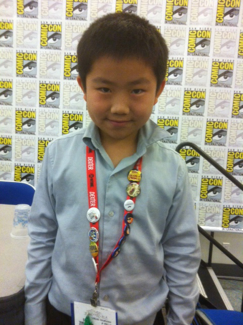 Perry Chen in front of a wall of Comic-Con logos