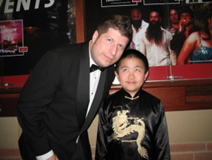 Kevin Sean Michaels and Perry Chen in formal attire at the Annie Awards